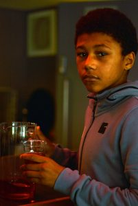 Young Person Assisting With Drinks