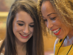 Girls Smiling At Phone