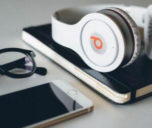 headphones, glasses, phone, desk